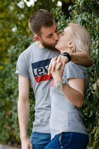 a woman kissing her boyfriend